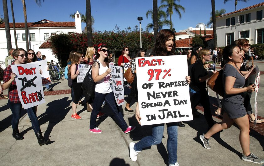 About two dozen San Diego State University students demonstrated on campus in December to demand the administration take more action in response to increased reports of sexual assaults.