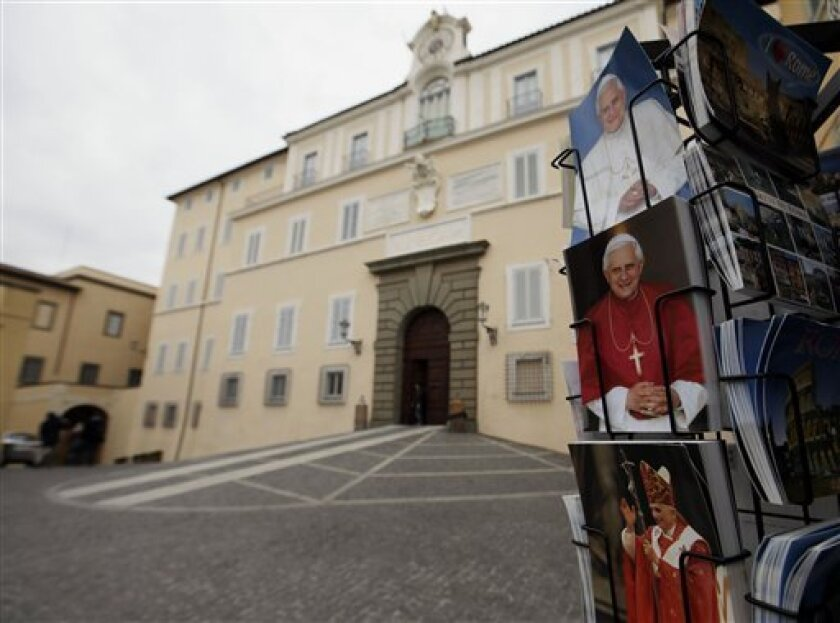 Pictures of Pope Benedict XVI are seen at a newsstand outside the pope's summer residence of Castel Gandolfo, in the town of Castelgandolfo, south of Rome, Wednesday, Feb. 20, 2013. Immediately after his resignation on Feb. 28, 2013, Pope Benedict XVI will spend some time at the papal summer retrea
