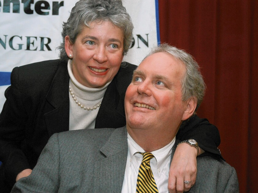 Lucinda Marker throws her arm around her husband, John Tull, at a 2004 news conference in New York. Both were diagnosed with bubonic plague during a 2002 visit to the city.