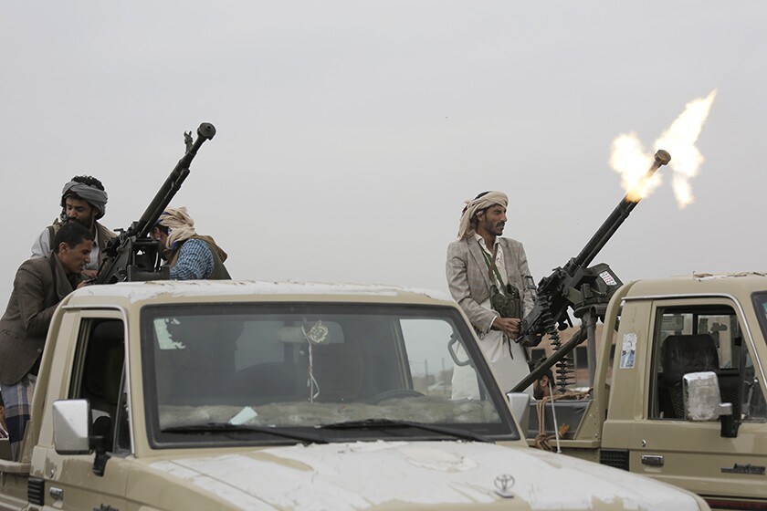A Houthi fighter fires in the air during a gathering in Sana, Yemen, in 2018.