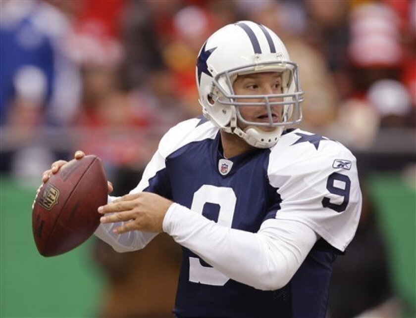 Dallas Cowboys quarterback Tony Romo (9) looks for a receiver during the first half of an NFL football game between the Dallas Cowboys and Kansas City Chiefs Sunday, Oct. 11, 2009, in Kansas City, Mo. (AP Photo/Orlin Wagner)