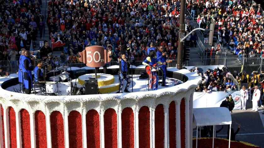 "Earth, Wind & Fire performs atop the ""50th Anniversary of the Forum"" float."