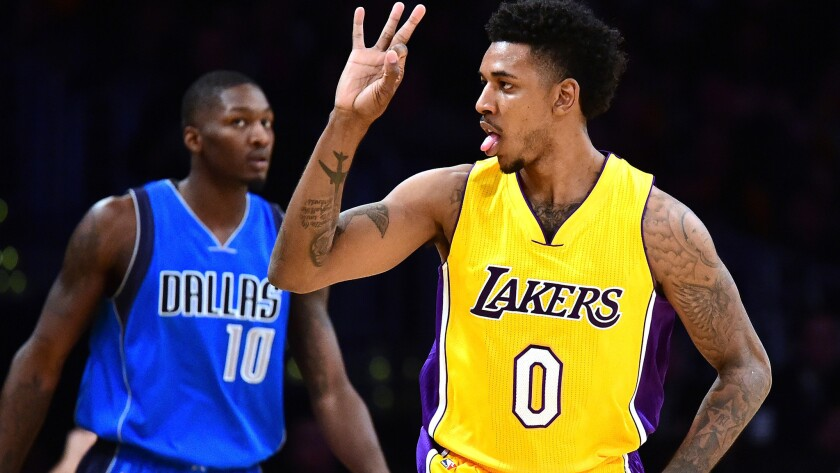 Lakers guard Nick Young celebrates after making a three-pointer against the Mavericks on Dec. 29.