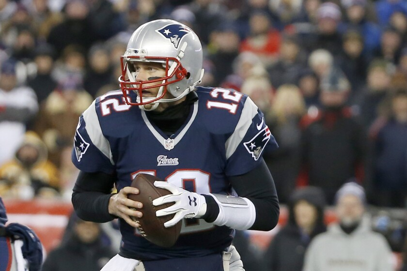 New England Patriots quarterback Tom Brady rolls out to pass during a divisional playoff game against the Baltimore Ravens on Jan. 10.