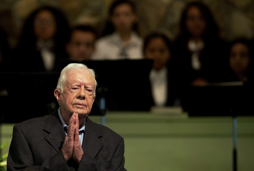 Former President Carter at prayer in 2015.