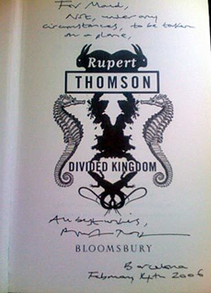 """What's the big deal about authors signing books? We asked some bloggers and authors to show us their most prized book signatures. Rupert Thomson sent Maud Newton an autographed copy of """"Divided Kingdom"""" after reading that she'd left her original copy on an airplane."""