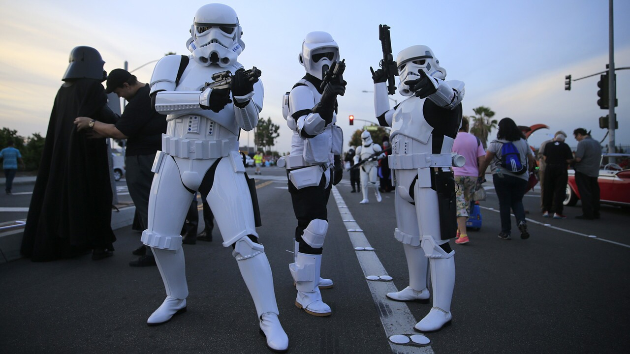 "Members of the 501st Legion and the Orange County Star Wars Society prepare to march in Stormtrooper costumes during the Anaheim Halloween Parade on Oct. 24. A group of cosplayers/fans dressed as their favorite ""Star Wars"" character march in the Anaheim Halloween Parade. ------------ For the Record: Oct. 30, 7:30 p.m. Slides 11 through 13 of this photo gallery incorrectly refer to the 501st Legion as the 501st Rebel Legion. ------------"