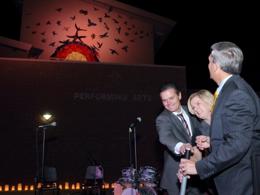 Principal Karl Mueller, Foundation President Amy Caterina, and county Supervisor Dave Roberts turn on the lights to reveal the mural at the Nov. 17 event. Photo by Jon Clark.