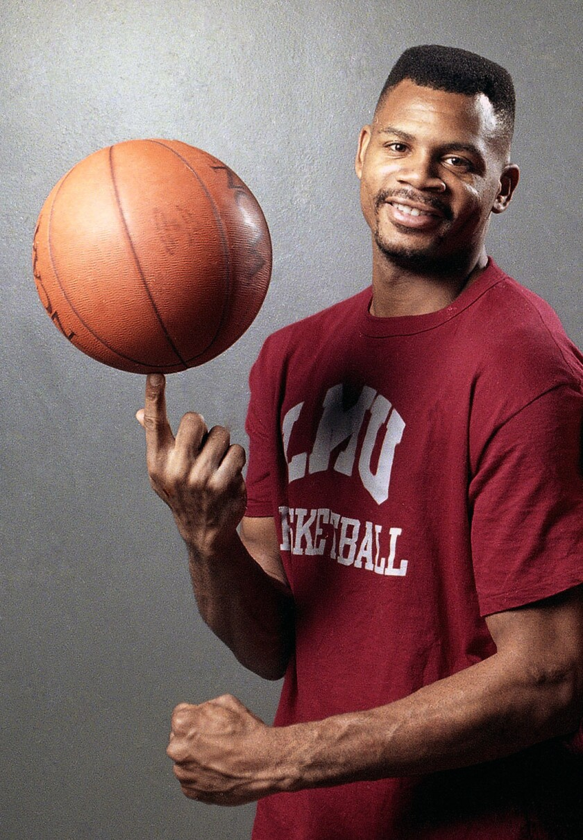 FILE - In this file photo taken Feb. 15, 1990, Loyola Marymount basketball player Hank Gathers pose before practice at the university's gym in Los Angeles. Loyola Marymount plans to unveil a statue of Hank Gathers this month to mark the 30th anniversary of the school's run to the Elite Eight after his fatal collapse on the court.. (AP Photo/Douglas C. Pizac, File)
