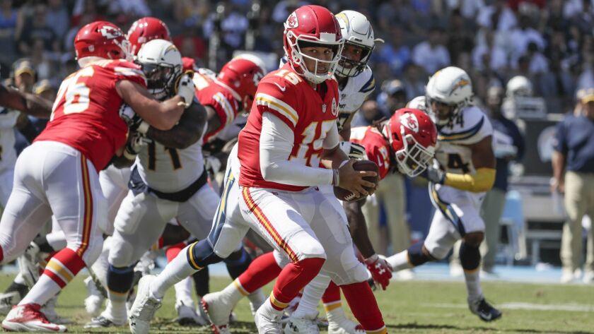 CARSON, CA, SUNDAY, SEPTEMBER 9, 2018 - Chiefs quarterback Patrick Mahomes looks over his shoulder o