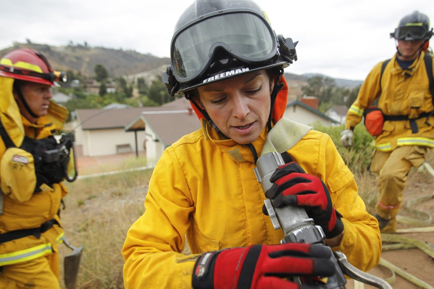 Palomar Fire Academy cadet Siene Freeman carries a hose during a wild land hose laying training session.