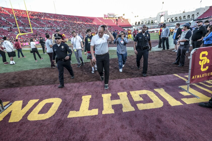 USC coach Clay Helton leaves the field after the Trojans beat UCLA on Nov. 23 at the Coliseum.