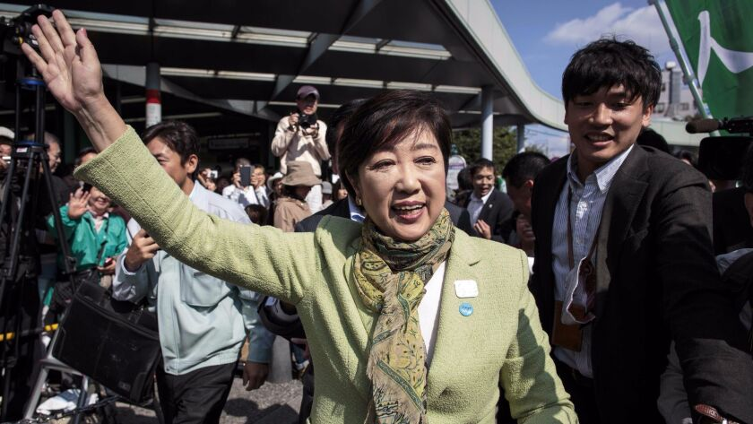 Tokyo Gov. Yuriko Koike greets her supporters during a campaign appearance Wednesday in Saitama.