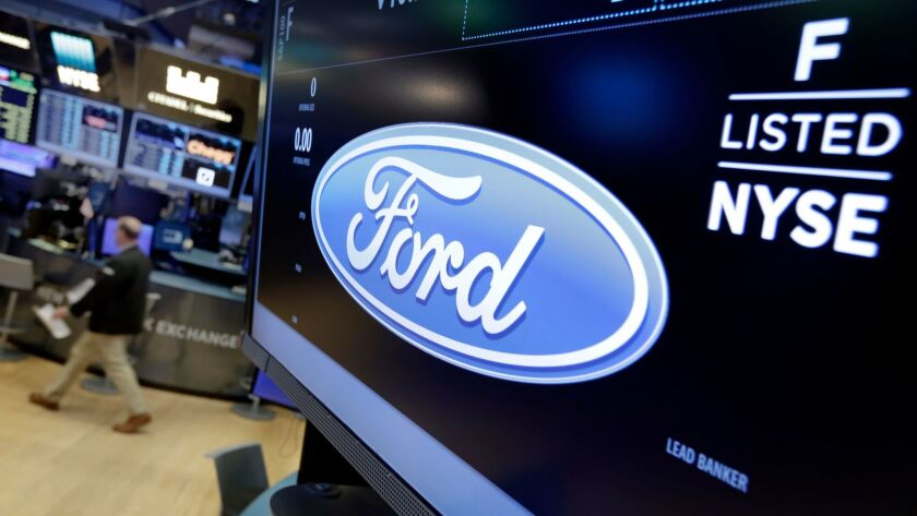 Ford is offering buyout packages to employees in North America and Asia.