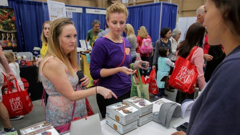Melissa Overland, left, and Kristen Douglas check out products at the Gluten Free & Allergen Friendly Expo in San DIego