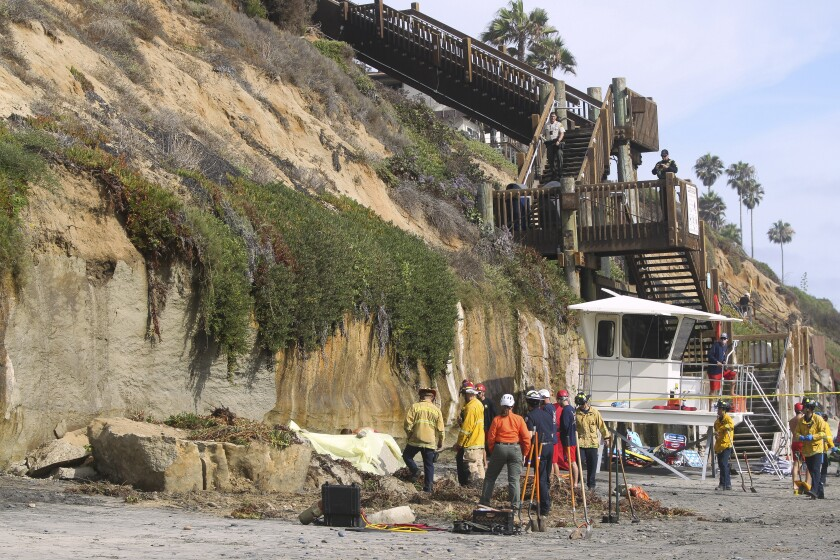 Three people died after an Encinitas beach bluff collapsed Friday afternoon.