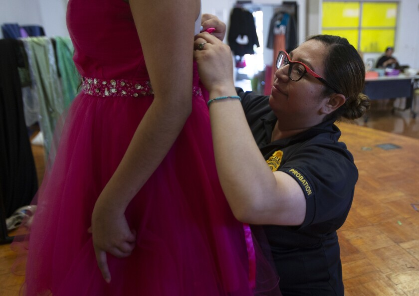 COMMERCE, CA-May 31, 2018 Aurora, 16, tries on prom dresses with help from Probation Officer Janet R