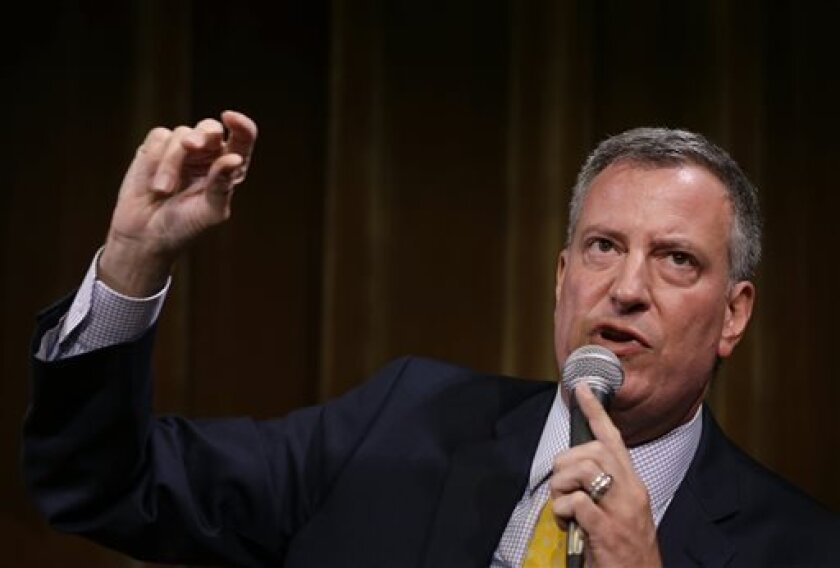 FILE - In this Tuesday, Aug. 13, 2013 file photo democratic mayoral hopeful Bill de Blasio speaks at a candidate forum in New York. Public Advocate Bill de Blasio has surged to a commanding lead in the city's Democratic mayoral primary, raising for the first time all campaign the possibility that a