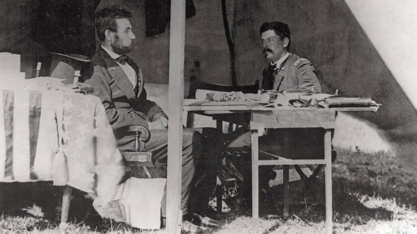 """This photo from """"The Civil War"""" shows President Abraham Lincoln conferring with George McClellan in the general's tent at Antietam in Maryland."""