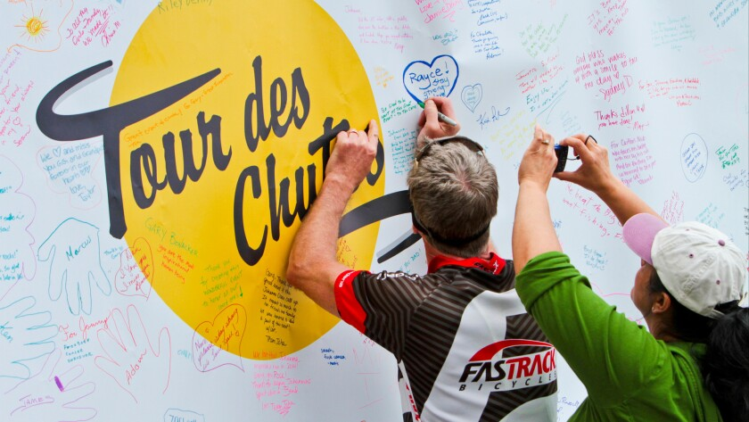 Ridders writing on the Tour des Chutes board.
