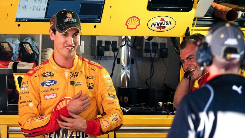 Joey Logano wins NASCAR Sprint Cup Series pole at Martinsville
