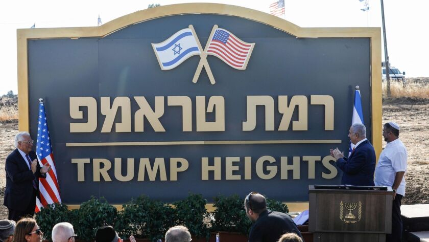 U.S. Ambassador David Friedman, left, and Israeli Prime Minister Benjamin Netanyahu, second from right, applaud Sunday at the inauguration of the newly renamed settlement of Ramat Trump, or Trump Heights.
