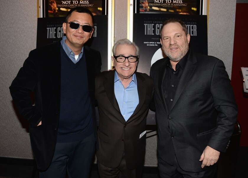 Director Wong Kar Wai, left, director Martin Scorsese and producer Harvey Weinstein attend a Q&A and reception in honor of Wong at Lighthouse International Theater in New York.