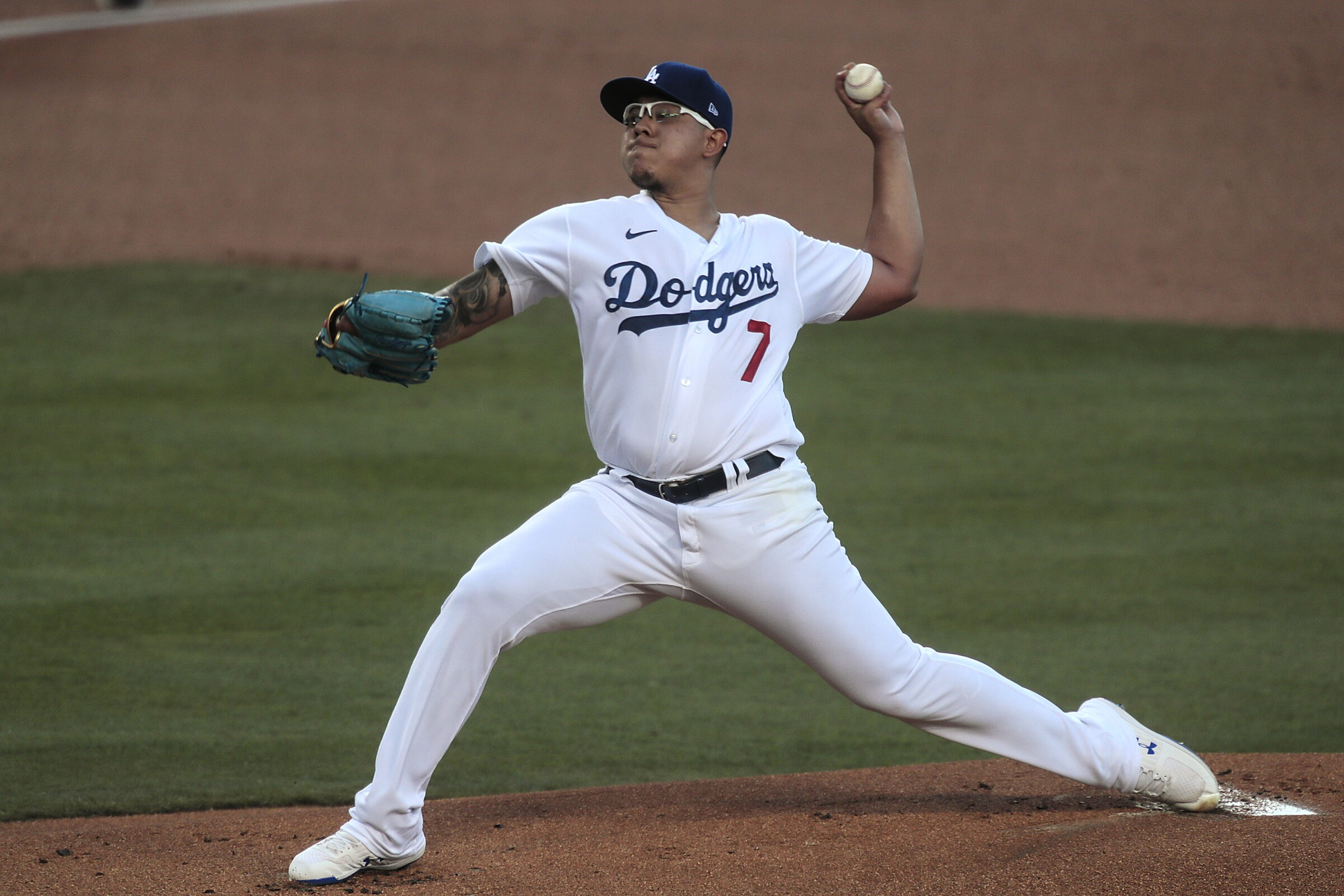 Dodgers pitcher Julio Urias delivers a first-inning pitch against the San Francisco Giants at Dodger Stadium on Sunday.
