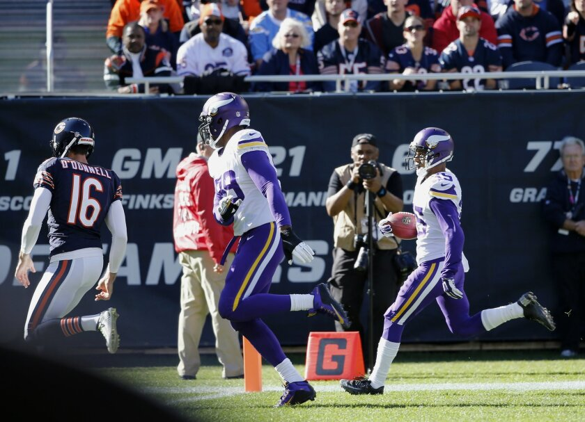 Minnesota Vikings' Marcus Sherels (35) runs to the end zone for a touchdown on a punt return during the first half of an NFL football game against the Chicago Bears, Sunday, Nov. 1, 2015, in Chicago. (AP Photo/Charles Rex Arbogast)