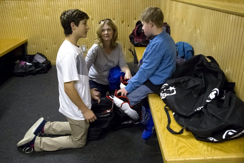 saiah Granet along with Adam's mother Sharla Hank try to convince Adam Hank to fully suit up in his hockey uniform for team practice of the San Diego Chill. Granet is a 14-year-old who has started a youth hockey team for developmentally disabled children. It started with two people and has grown to