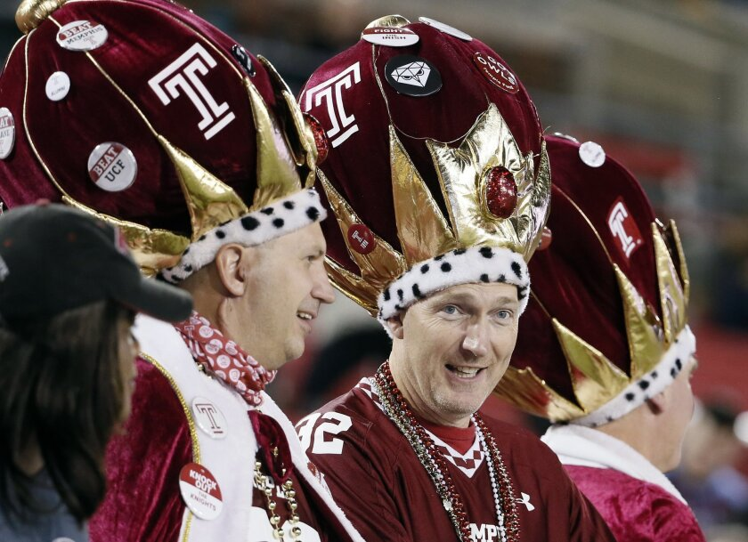 Temple fans wear costumes as they watch the first half of an NCAA college football game against SMU, Friday, Nov. 6, 2015, in Dallas. (AP Photo/Tony Gutierrez)