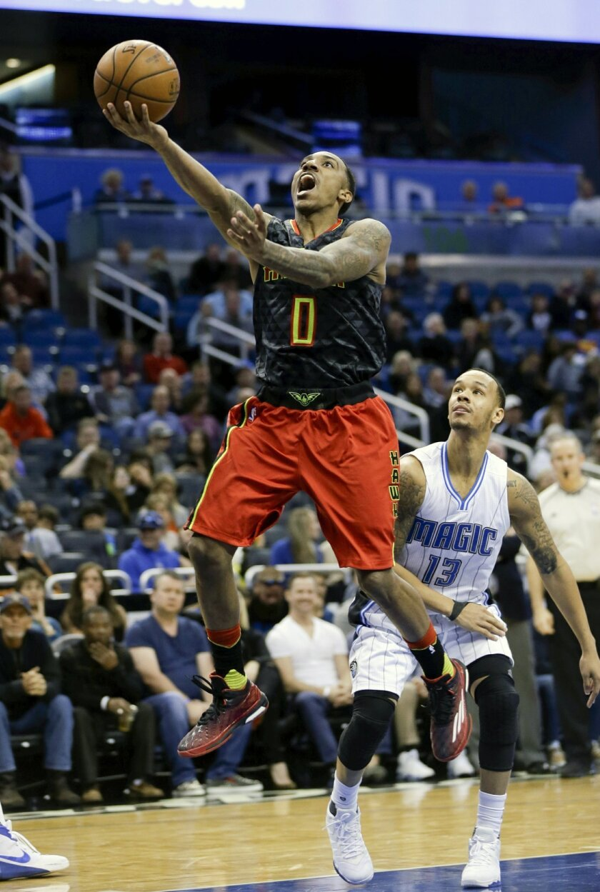 FILE - In this Feb. 7, 2016, file photo, Atlanta Hawks' Jeff Teague (0) goes to the basket past Orlando Magic guard Shabazz Napier (13) during the second half of an NBA basketball game, in Orlando, Fla. The Hawks could look to shake things up and give themselves a boost while sitting in the fourth