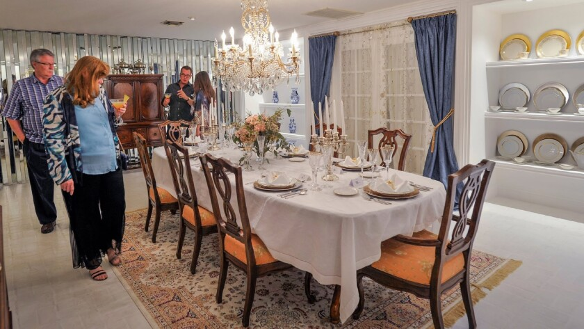 Guests walk through the dining room of the Liberace Mansion during the Nevada Preservation Foundatio