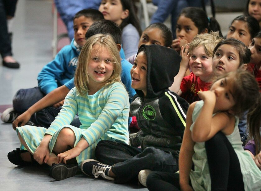 March 11, 2016, Escondido, California, USA_| Kids at Miller Elementary School listen to prominent children's book author Eric Ode speak and play songs for them this morning. The Assistance League of Inland North County funded his visit. The organization raises money through thrift shop sales to bring kid's authors to speak at local schools. |_Mandatory Photo Credit: Photo by Charlie Neuman/San Diego Union-Tribune/©2016 San Diego Union-Tribune, LLC