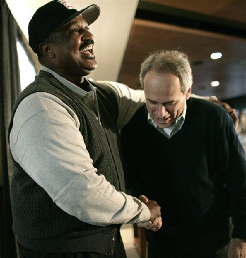 Former Boston Red Sox player Jim Rice, left, smiles next to Red Sox president and CEO Larry Lucchino, right, after a news conference at Boston's Fenway Park, Monday, Jan. 12, 2009, held to announce that Rice was elected to the baseball Hall of Fame. Rice joins Carl Yastrzemski, Ted Williams and Bob