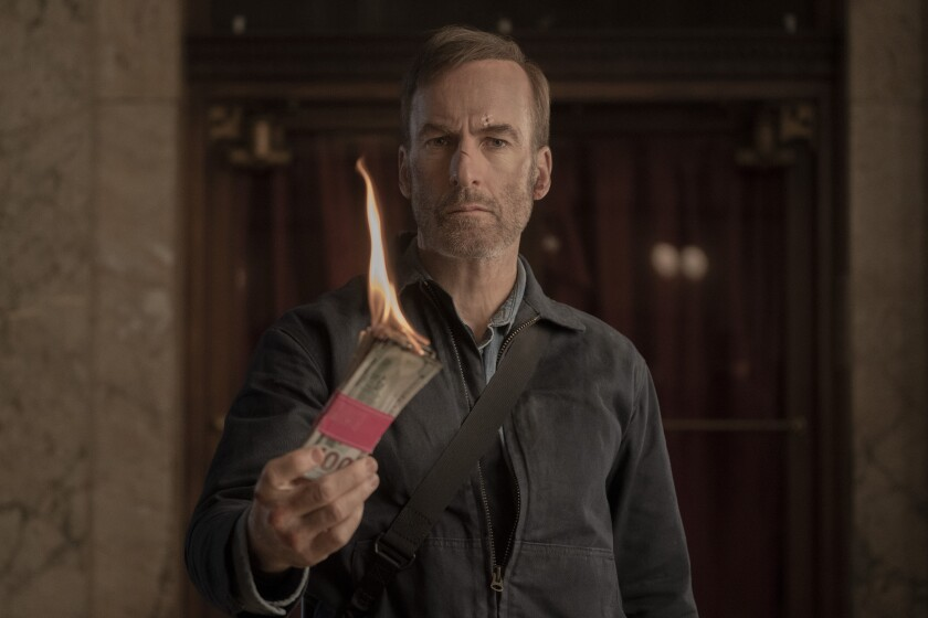 """Bob Odenkirk, as Hutch Mansell, burns a stack of money in """"Nobody,"""" directed by Ilya Naishuller."""
