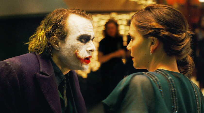"""Heath Ledger stars as The Joker and Maggie Gyllenhaal stars as Rachel Dawes in Warner Bros. Pictures and Legendary Pictures """"The Dark Knight."""""""