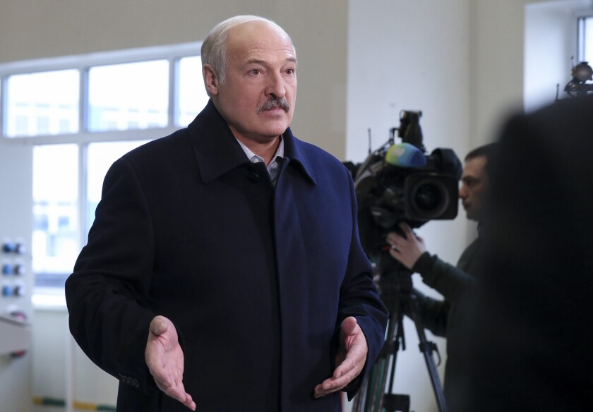 Belarusian President Alexander Lukashenko speaks to journalists as he visits the Dobrush Paper Factory in Dobrush, Belarus, Tuesday, Feb. 4, 2020. Lukashenko boasted about Belarus' warmer ties with the United States as he prepared to meet with Russian President Vladimir Putin for another round of difficult economic talks. (Nikolai Petrov/BelTA Pool Photo via AP)