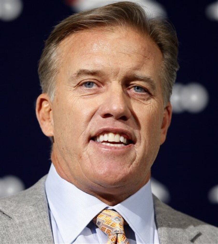 Hall of Fame quarterback John Elway speaks during an NFL football news conference at the Denver Broncos' headquarters Wednesday, Jan. 5, 2011, in Englewood, Colo., where he was named the team's executive vice president of football operations. (AP Photo/ Ed Andrieski)