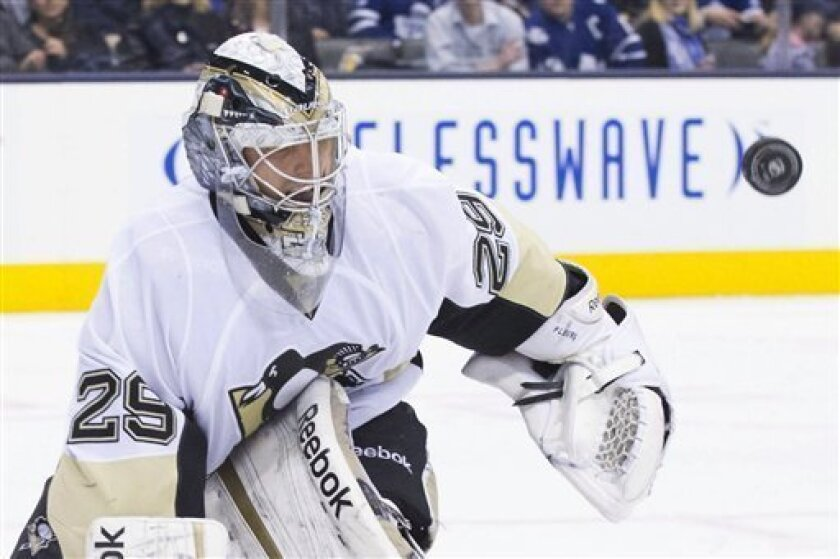 Pittsburgh Penguins goaltender Marc-Andre Fleury makes a save against the Toronto Maple Leafs during the second period of an NHL hockey game in Toronto on Saturday, March 9, 2013. (AP Photo/The Canadian Press, Chris Young)