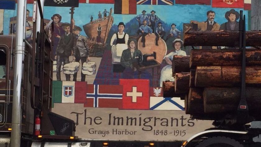 A logging truck is parked in front of a mural in Aberdeen, Wash. Many in the Washington timber industry voted for Donald Trump for president.