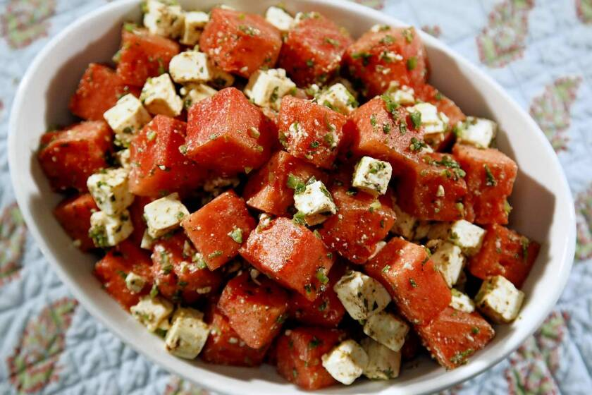 Cubed watermelon is combined with feta, mint, a little jalapeno and a cumin-lime dressing. Recipe: Watermelon salad with feta, mint and cumin-lime dressing.