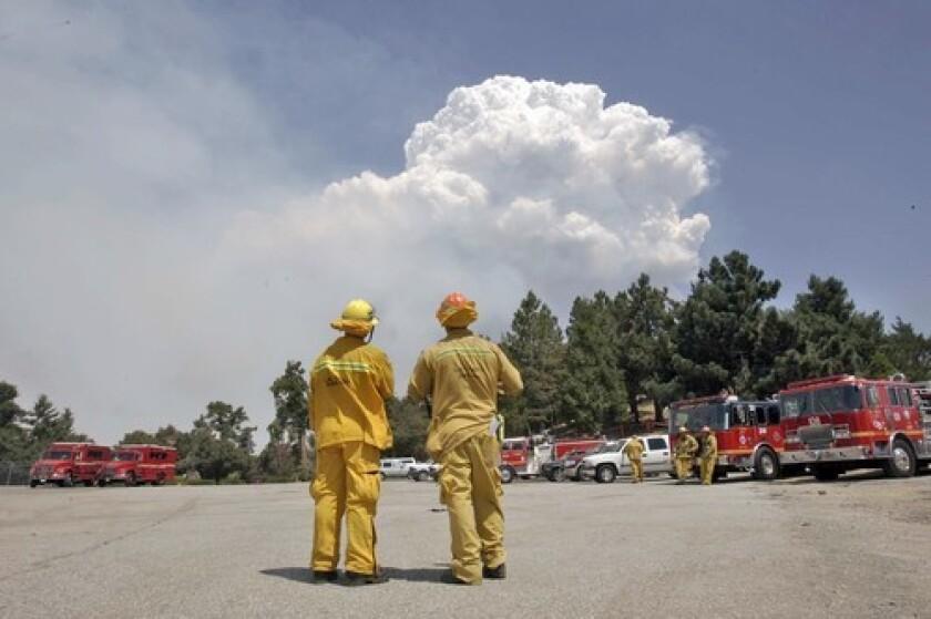 Smoke rises above Mt. Wilson. Fire officials came to Sacramento to seek legislators' help.