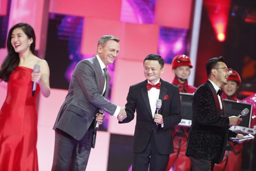 """Actor Daniel Craig, who plays James Bond in the 007 film """"Spectre,"""" with Alibaba founder Jack Ma on a TV gala Tuesday night."""