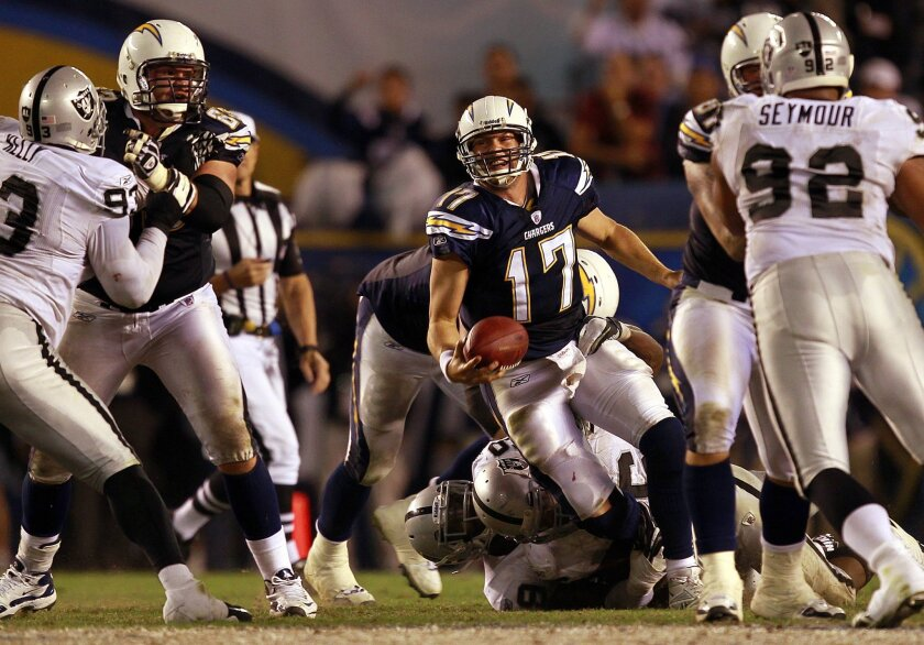 Chargers quarterback Philip Rivers is taken down on the second-to-last play of Sunday's finale. In the final four games, Rivers threw eight touchdown passes and no interceptions. K.C. Alfred • u-t