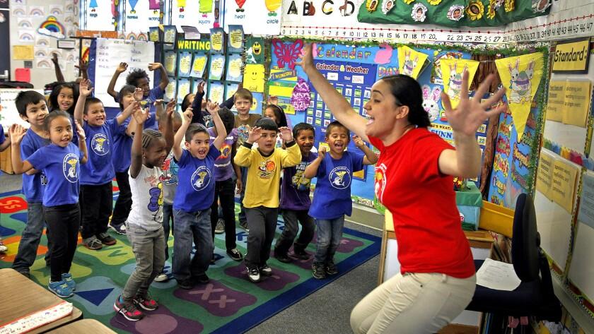 Kindergarten teacher Adriana Rosas with her class at Aloha Health Medical Academy in Lakewood.