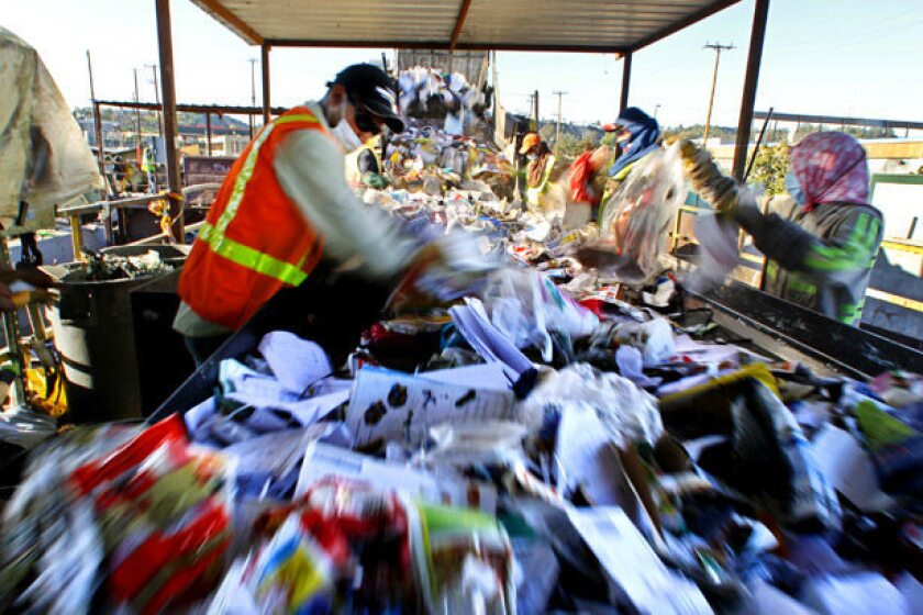 Workers sort through recyclables at Los Angeles Recycling Center.