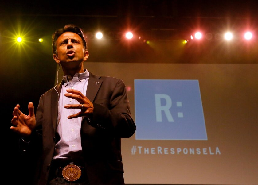 Louisiana Gov. Bobby Jindal speaks during a prayer rally in Baton Rouge last month. Did the prayer agenda include asking divine help to keep a local ER open?