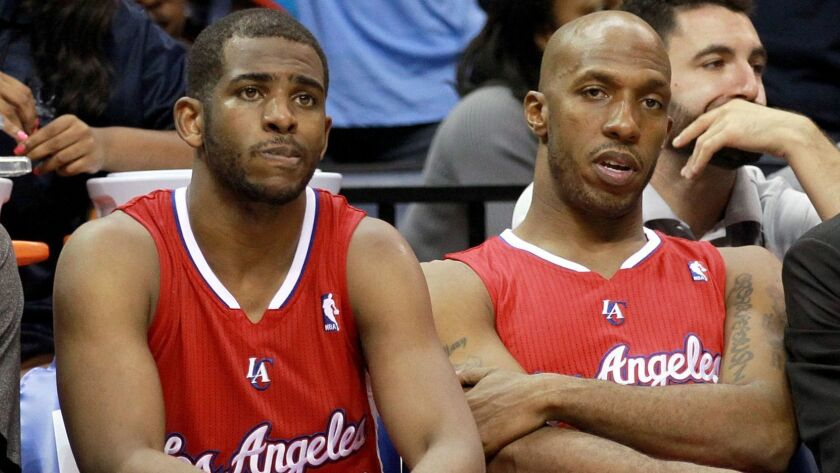 Chris Paul, left, and Chauncey Billups sit on the Clippers bench in 2013.