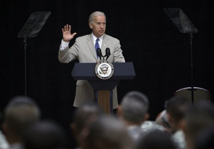 U.S. Vice President Joe Biden speaks to troops at a naturalization ceremony at al-Faw Palace on the western outskirts of Baghdad, Iraq, Saturday, July 4, 2009. Biden was in attendance as some 237 soldiers from 59 countries tool the oath during his visit to Iraq. (AP Photo/ Khalid Mohammed)